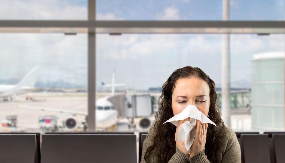 sneezing woman sick blowing nose