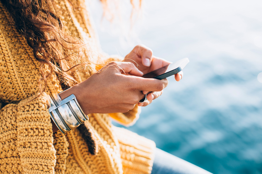 Young woman hands using phone